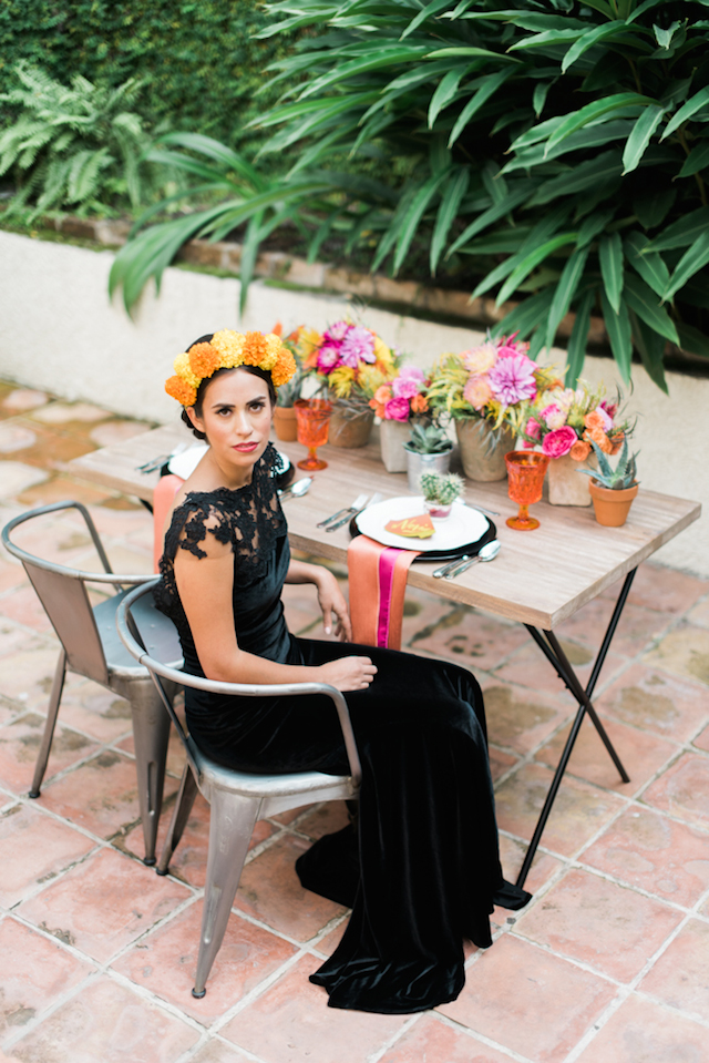 a black lace top, cap sleeves black velvet wedding dress for a Dia de los Muertos bride