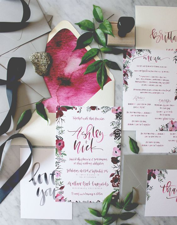 berry-hued watercolor wedding invitations with floral prints
