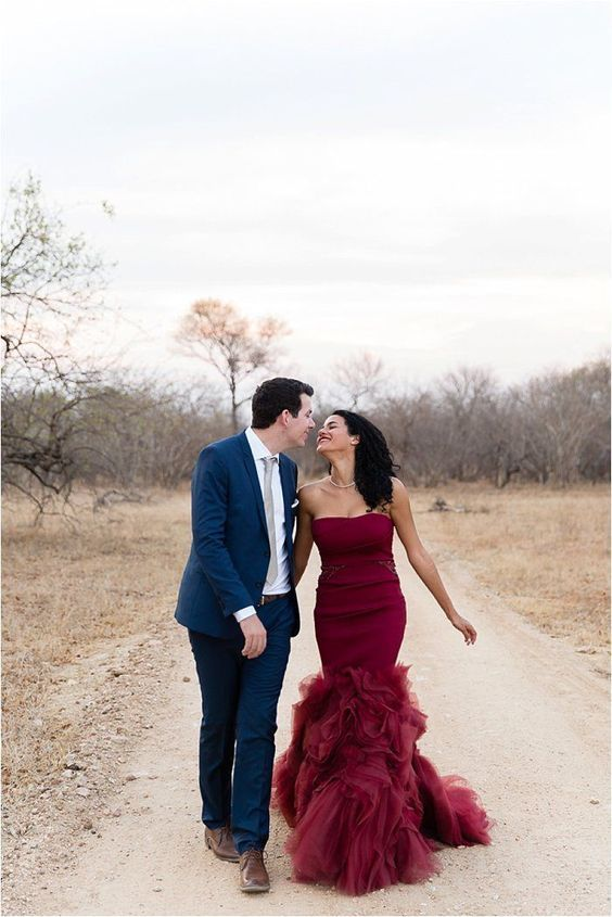 burgundy mermaid wedding dress with beading and a ruffled 'tail'