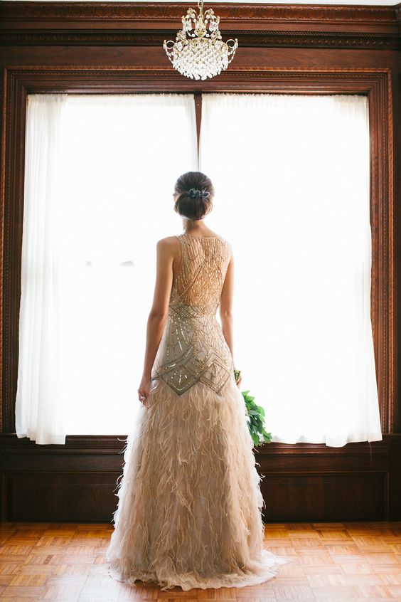 sparkling gold embroidery wedding dress with a feather skirt and an illusion back