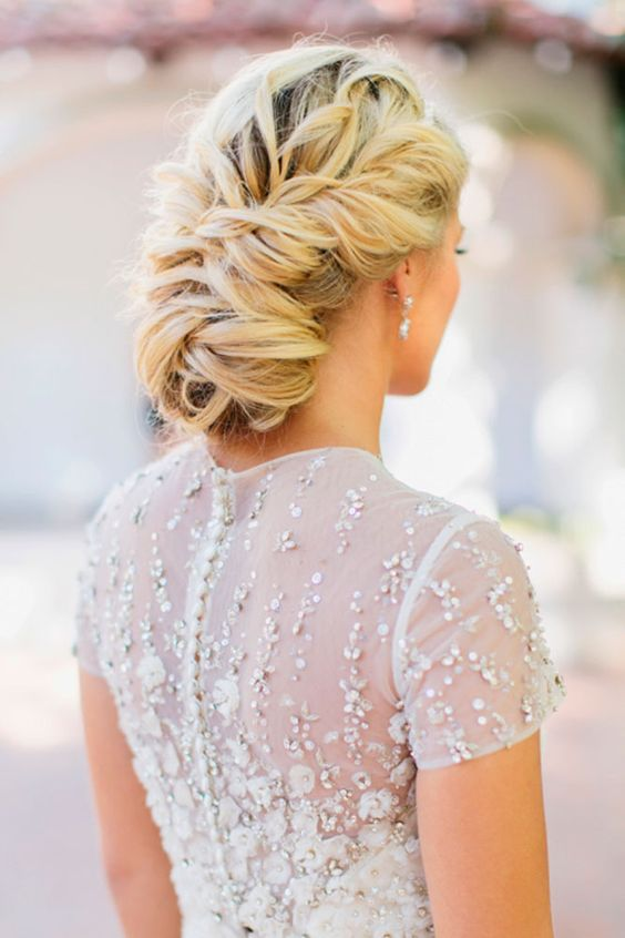 twisted wedding low updo shows off the volume