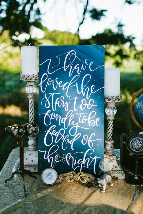 navy constellation wedding sign with an appropriate quote