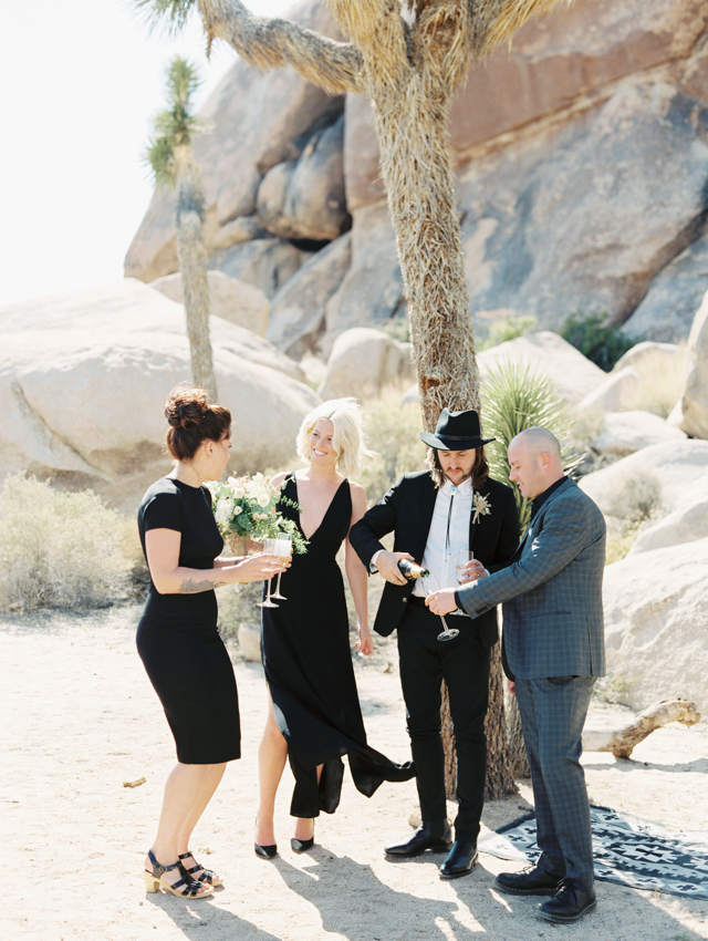 plunging neckline sleeveless black midi dress with a side slit for a minimalist bride