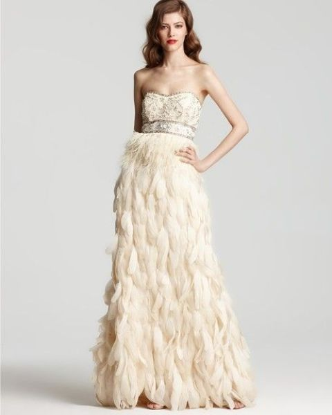 strapless wedding dress with a crystal and beaded bodice and a feather skirt