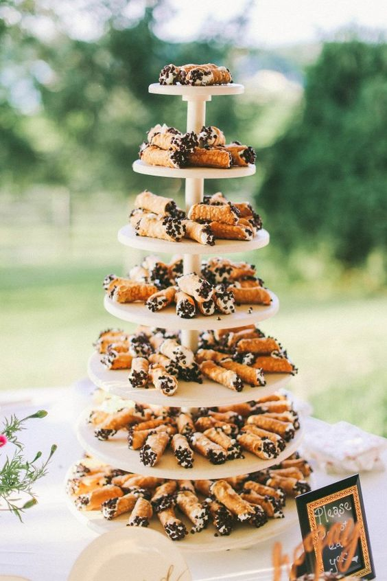 a cannoli tower will easily substitute any wedding cake and will be very eye-catchy