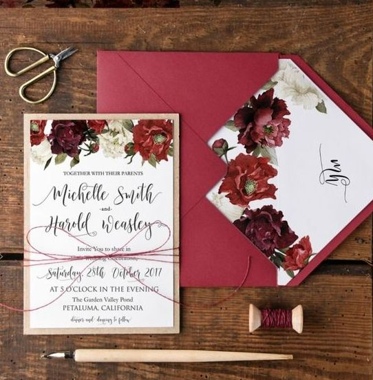 berry-hued wedding invites with floral prints and kraft paper envelopes