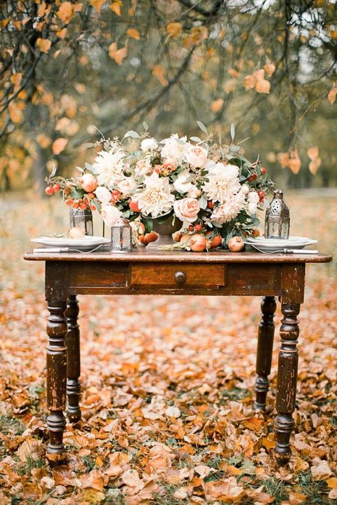fall garden tablescape with ivory and blush blooms and fruit