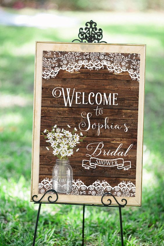 framed pallet sign for a rustic bridal shower, decorated with lace