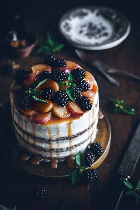 peach carrot cake with cream cheese frosting, blackberries, peaches and peach drip