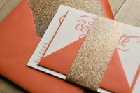 28 bold orange envelopes with gold glitter lining and details