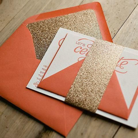 bold orange envelopes with gold glitter lining and details