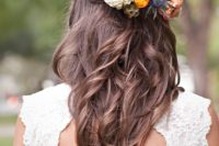 28 braided wavy half updo with a bold floral hairpiece to embrace the season
