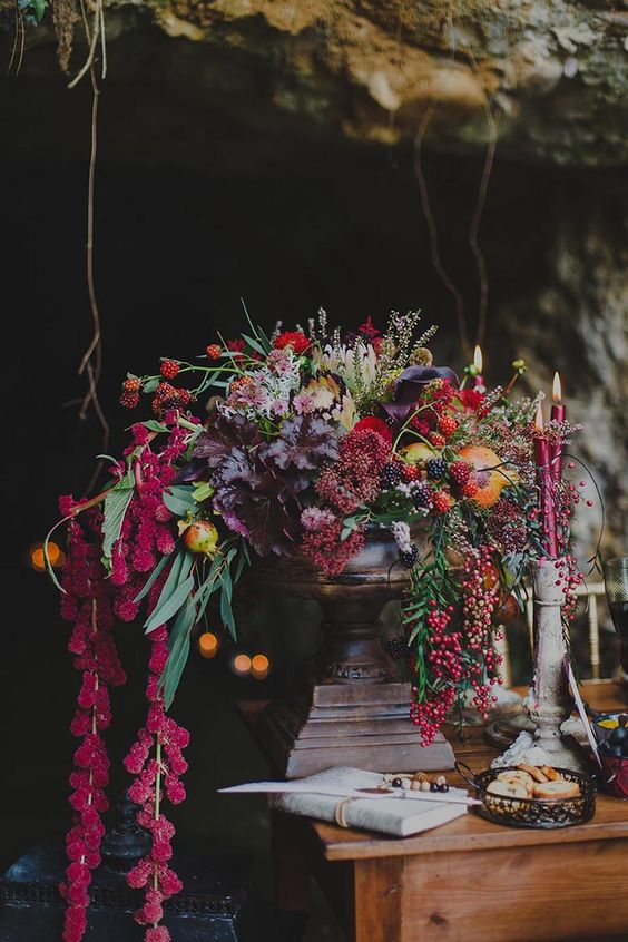 lush floral centerpiece with berries, leaves and greenery