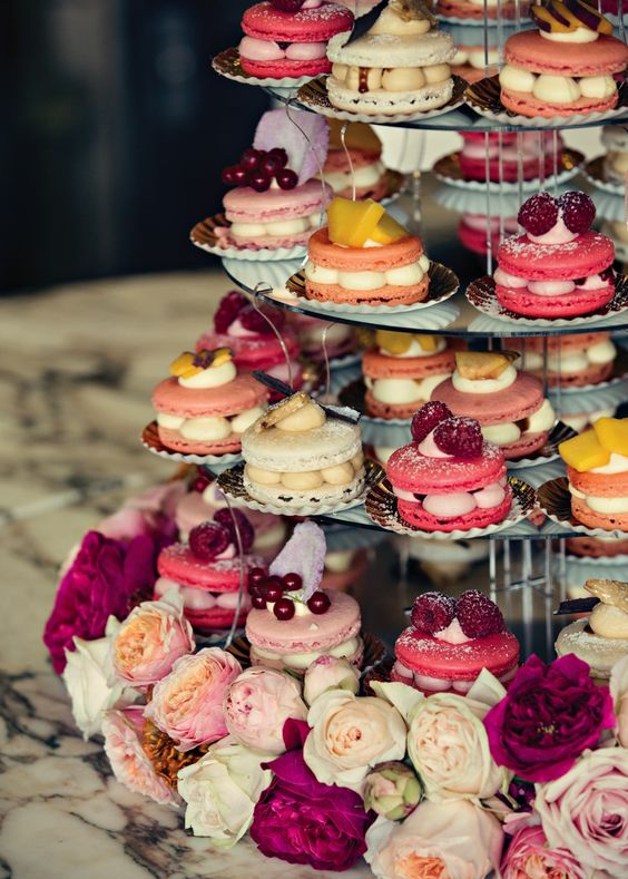 macaron sandwich tower with different fillings and toppers looks impressive