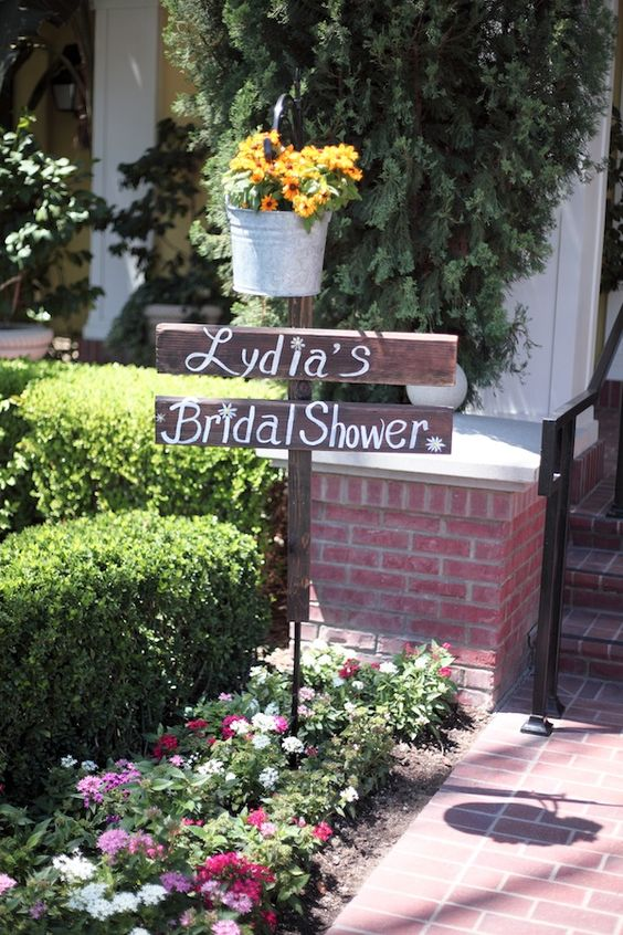 rustic signs and a bucket with flowers to welcome guests
