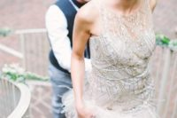 28 sparkling silver bodice sleeveless wedding dress with a feathered skirt