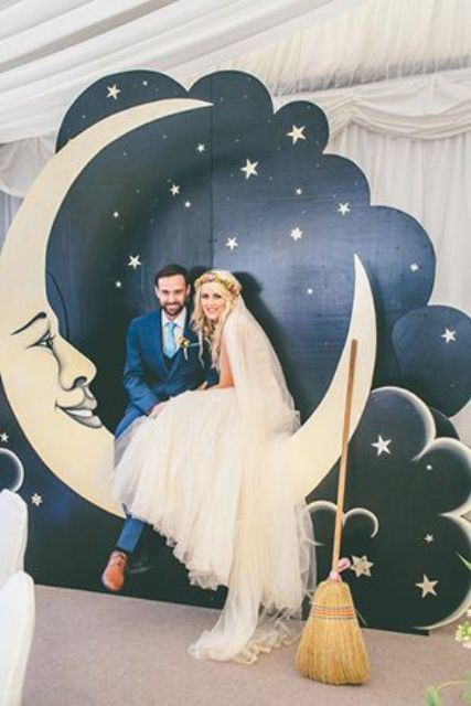 starry sky and half moon photo booth is a great and timeless idea