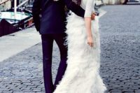 29 a flirty wedding separate with a plain bodice and half sleeves and a feather skirt