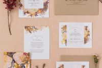 29 cool fall-colored flower printed wedding stationary and a kraft paper envelope