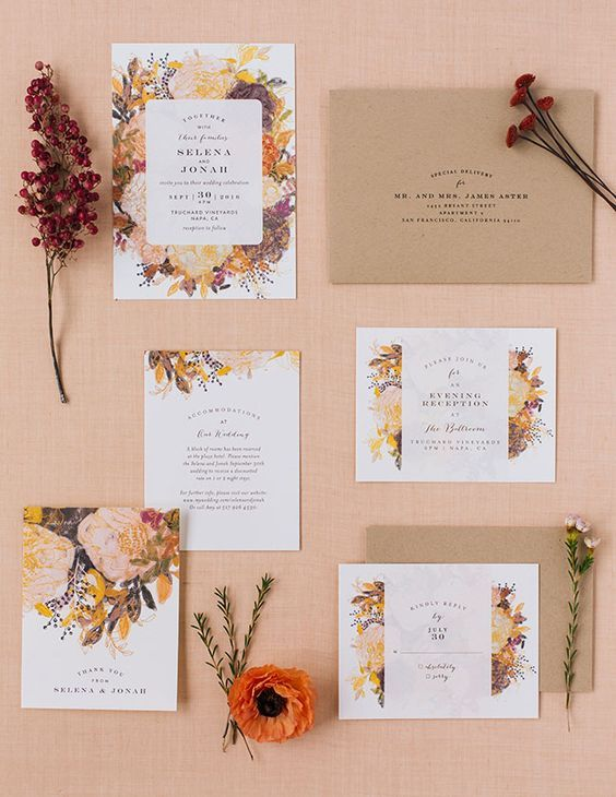 cool fall-colored flower printed wedding stationary and a kraft paper envelope
