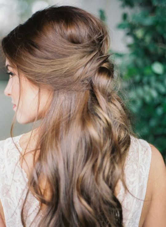 half up half down hairstyle with waves and messy touches