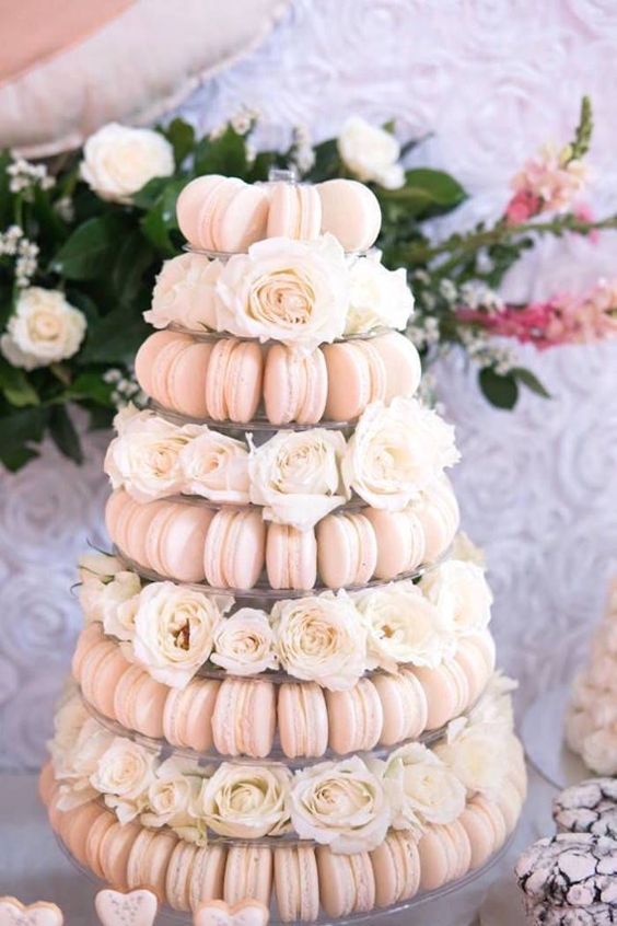 blush macaron wedding tower served with fresh white roses