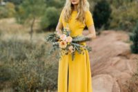 30 yellow short sleeve wedding dress with a front slit for a fall bride