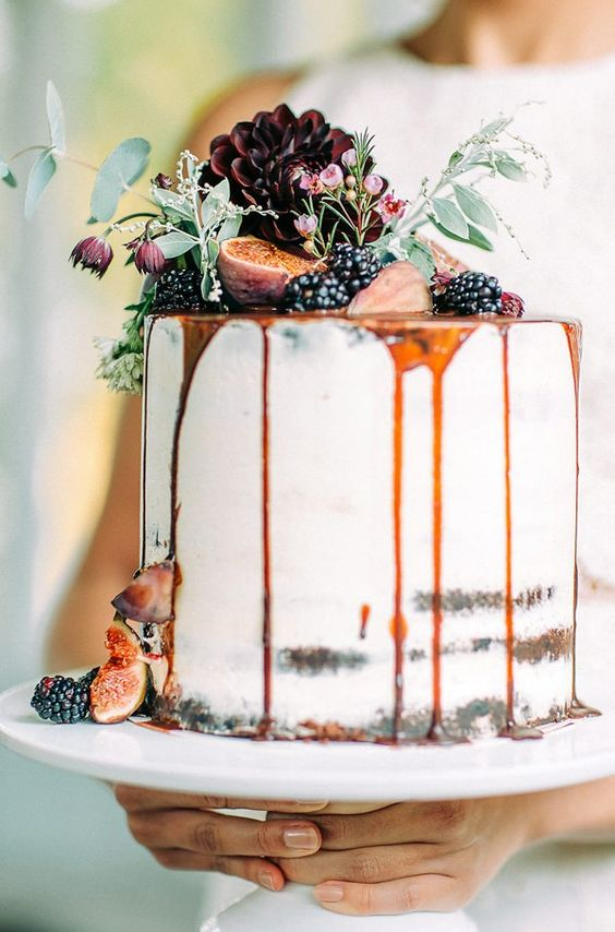 semi naked drip wedding cake with caramel drip, blackberries, figs and dark dahlias