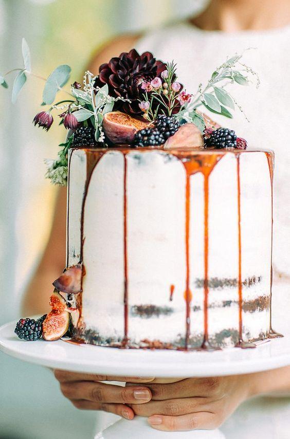 semi naked drip wedding cake with caramel drip, blackberries, figs and dark dahlias