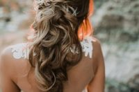 31 twisted curly half updo accessorized with a rhinestone hairpiece on one side