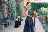 32 midnight blue illusion neckline high low wedding dress with short illusion sleeves