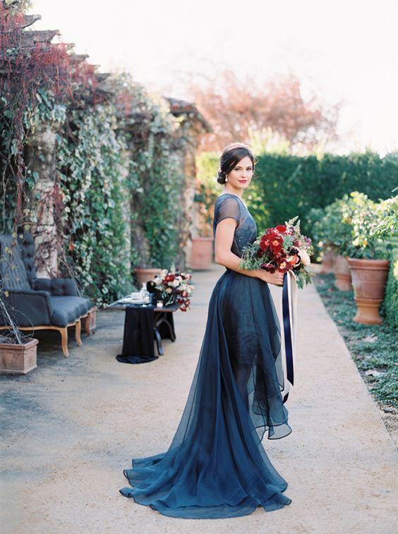 midnight blue illusion neckline high low wedding dress with short illusion sleeves
