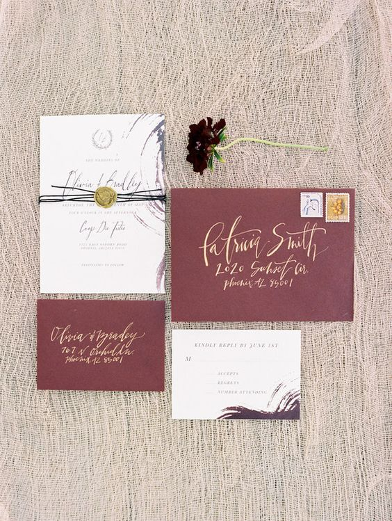 pink envelopes with gold calligraphy and neutral invites