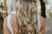 32 twisted half updo with waves and a fall flower headpiece