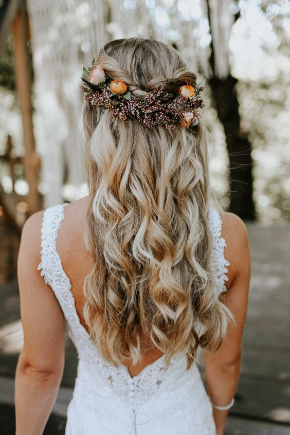 twisted half updo with waves and a fall flower headpiece