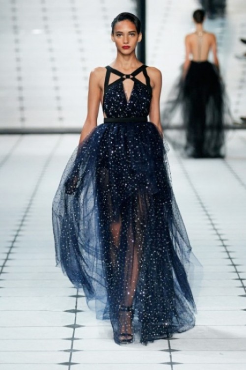 midnight blue sparkling wedding dress with a layered skirt and a strappy bodice