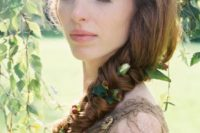 34 long twisted braid with greenery and berries tucked in for a boho or woodland bride