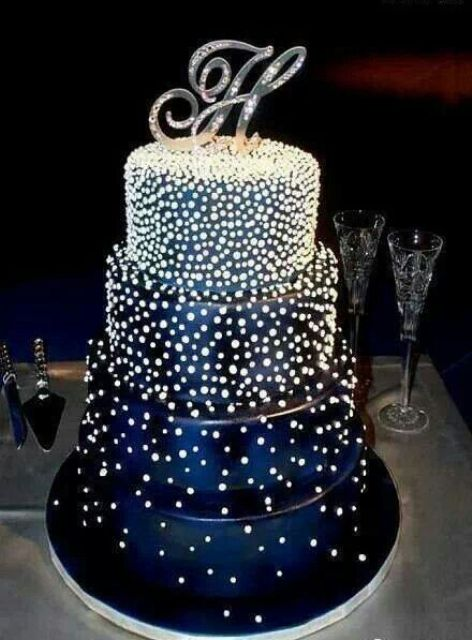 Picture Of navy sparkling starry wedding cake with a monogram topper