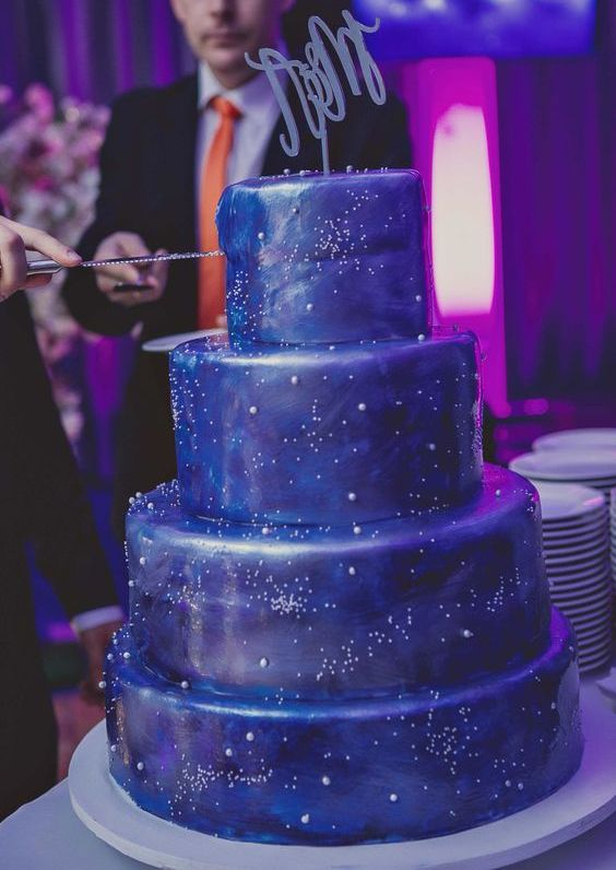 starry night wedding cake with different stars and constellation