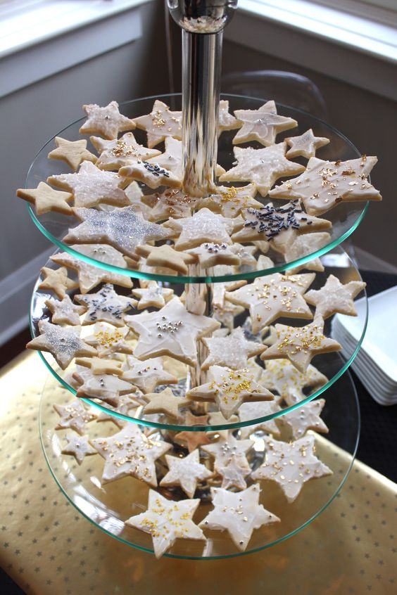 star shaped cookies with gold and silver leaf and edible beads