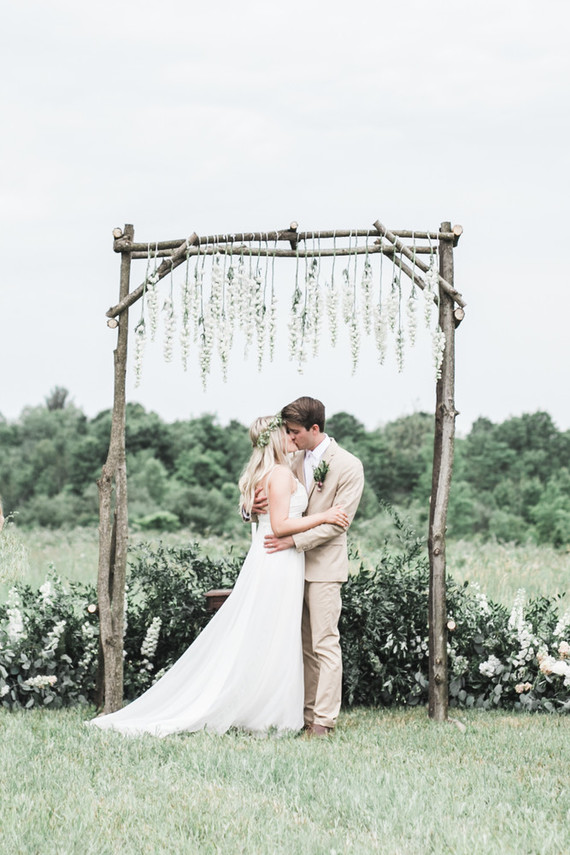 This earthy summer meadow wedding was done in soft neutral tones