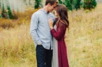 02 the bride-to-be is wearing a grey midi dress and a long plum-colored cardigan and greey booties to embrace the fall