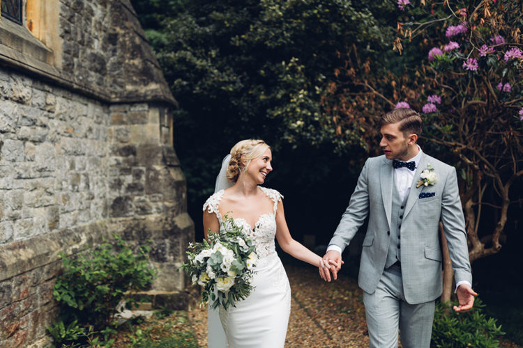The bride was weaing a lace bodice dress with a plain skirt by Berta, a veil and emerald earrings, the groom preferred a grey three-piece suit with a polka dot bow tie