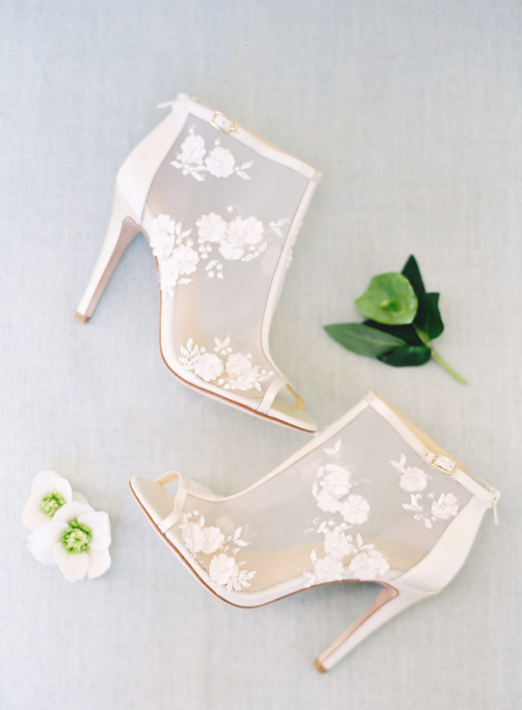 The bride was wearign gorgeous peep toe booties with floral lace appliques