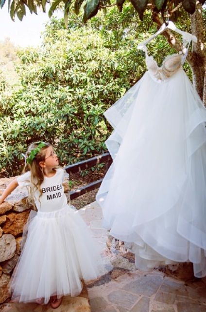 The bride was wearing a unique customized dress with a lace bodice and a layered tulle skirt