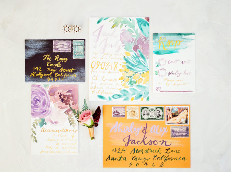The colorful wedding invitation suite was done with watercolor florals
