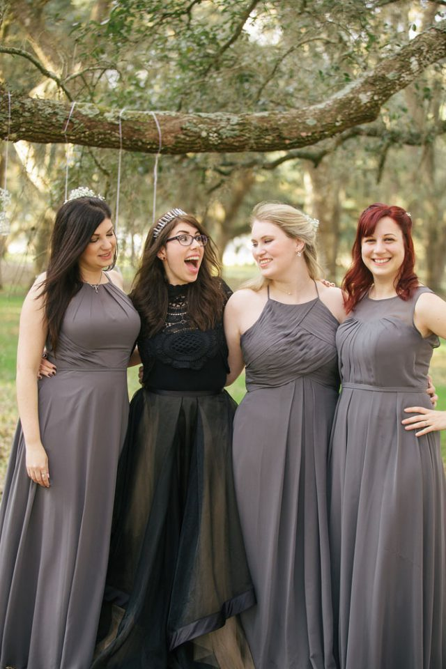 Thebride was wearing a black lace top, a black tulle skirt and a handmade headpiece from hematite crystals. the bridesmaids were wearing mismatching grey maxi gowns