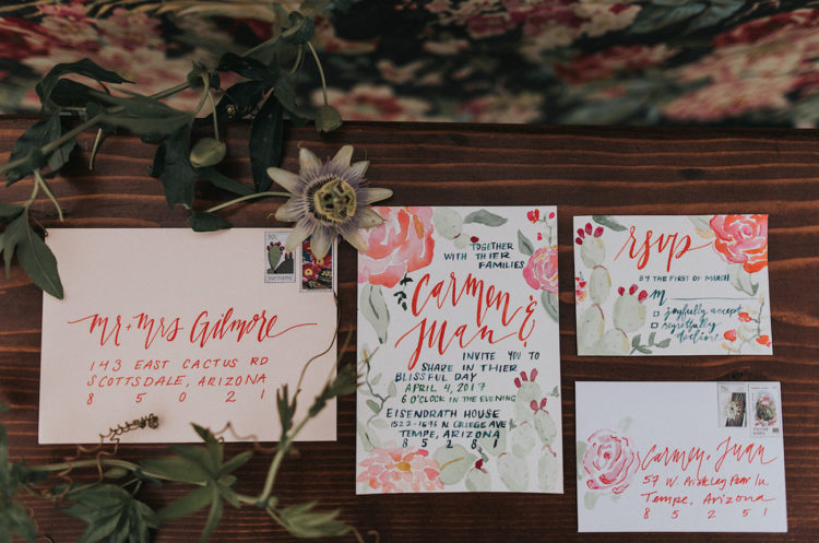 Watercolor invitation suite with red and muted green touches