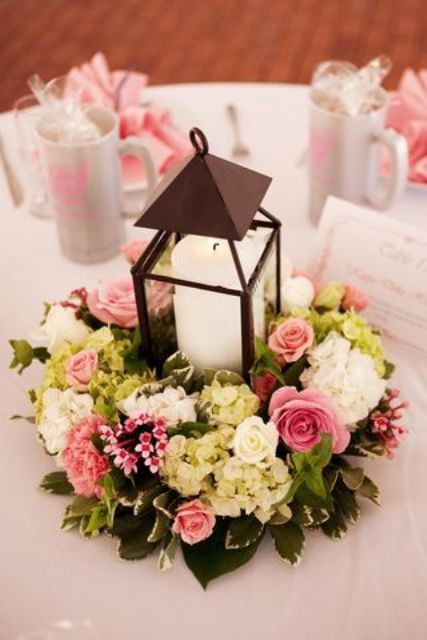 A Black Candle Lantern With Pink And Neutral Floral Arrangement As Pretty Centerpiece