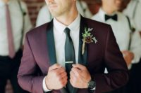 02 a burgundy and black wedding suit with a white shirt and a black tie